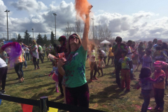 Angela throwing colors at the Festival of Colors.